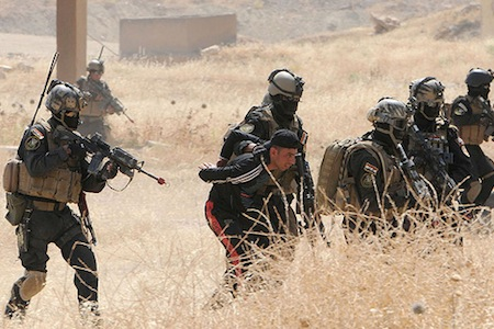 "Iraqi Special Operation Forces arresting a ""suspect"" in a training operation in 2009. Credit: Flickr/U.S. Army."