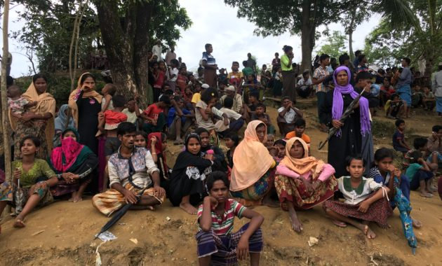 A group of Rohingya refugees, who had recently arrived in the Bangladesh camp of Kutupalong, waiting for humanitarian assistance, October 2017.